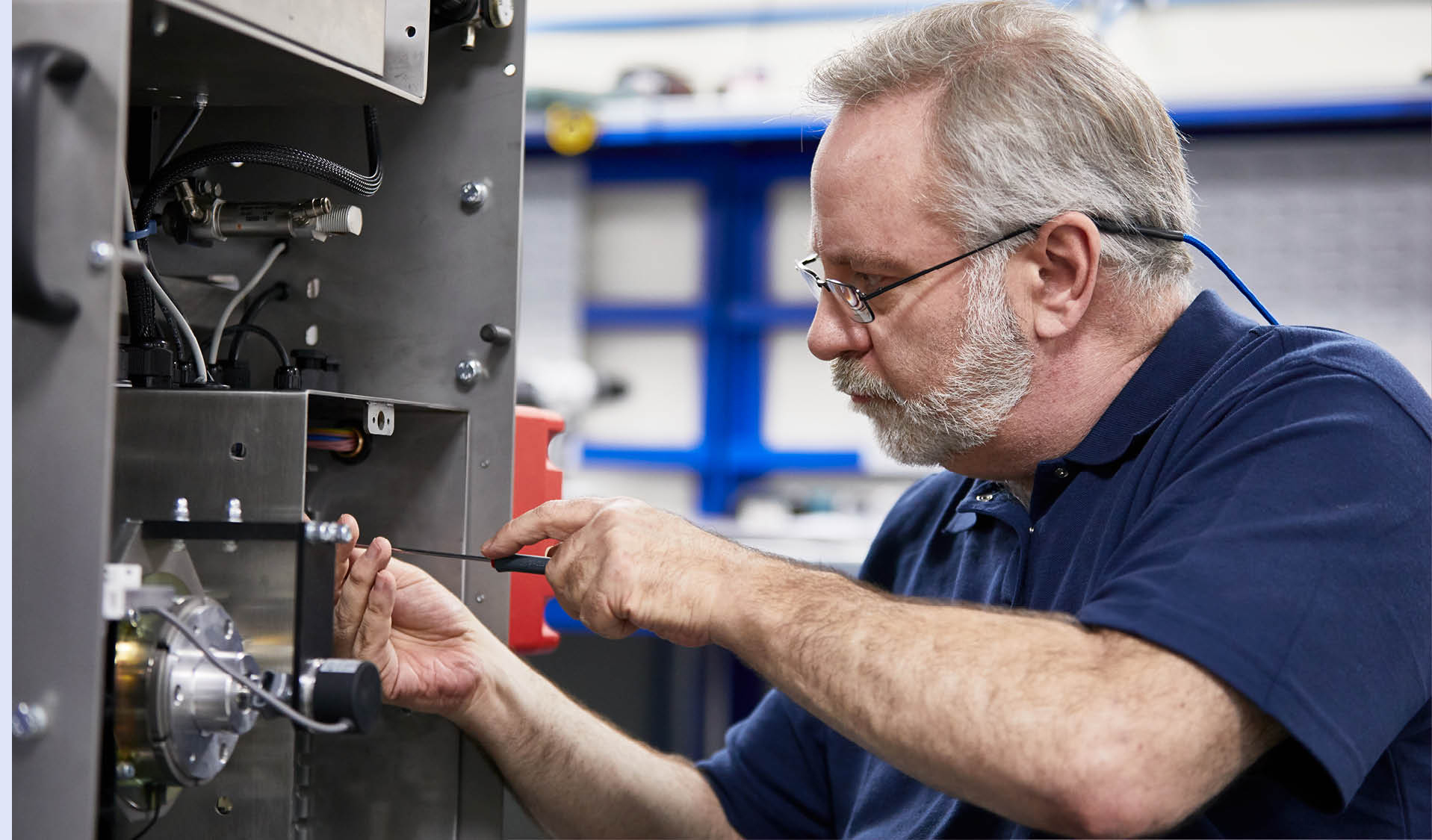 Service engineer for We Seal performs maintenance on bag sealing machine